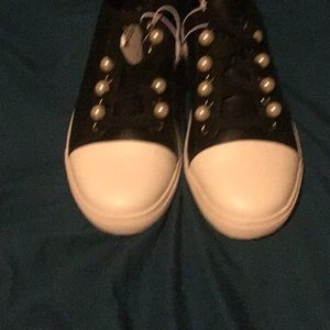 Black sneakers with pearls and bonded leather